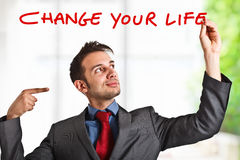 Change your life. Friendly businessman suggesting you to improve your life Stock Photo