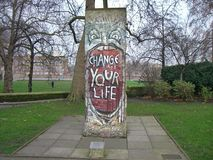 `Change your Life` written on a piece of the Berlin wall royalty free stock photo