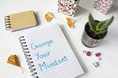 Change your mindset written in notebook. On white table stock photography