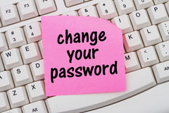 Change your password. Computer Keyboard with a pink blank sticky note with text Stock Photos