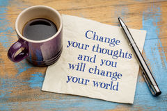 Change your thoughts and world. Change your thoughts and you will change your world - handwriting on a napkin with a cup of espresso coffee stock photography