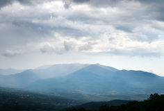 Changeable weather in mountains. Royalty Free Stock Photography
