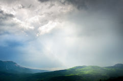 Changeable weather in mountains. Stock Photos