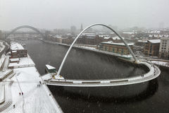 Changeable Weather. Snow covers Millenium Bridge, Newcastle Stock Image