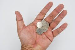 Changement de pièce de monnaie après payé à disposition Photo stock