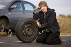 Changement de pneu Photographie stock libre de droits