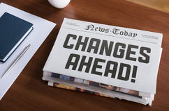 Changes ahead. Newspaper with hot topic Changes Ahead lying on office desk Royalty Free Stock Photography