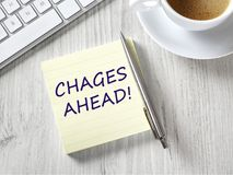 Changes ahead from above. Changes ahead message on adhesive note Royalty Free Stock Image