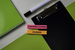 Changes coming in 2020 text on top view office desk table of Business workplace and business objects royalty free stock photos