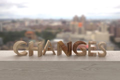 Changes. 3d rendering of the word changes over a wooden surface Stock Images