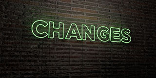 CHANGES -Realistic Neon Sign on Brick Wall background - 3D rendered royalty free stock image Stock Photography