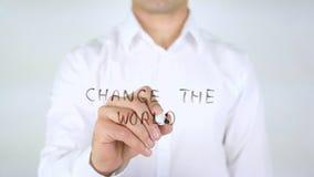 Changez le monde, écriture d'homme sur le verre, manuscrit Photo stock