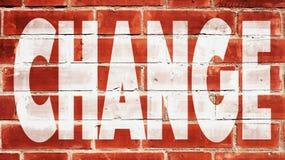 Changez sur un mur de briques Photo libre de droits
