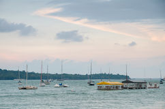 Changi Boardwalk. Changi, Singapore - April 30, 2017: Small private yacht anchored along the Changi Boardwalk span a 2.2 km and includes a jogging track, fitness Royalty Free Stock Photo