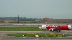AirAsia Airbus 320 taxiing. Changi, Singapore - November 25, 2018 : AirAsia Airbus 320 HS-CBF taxiing before departure at Changi airport, Singapore stock footage