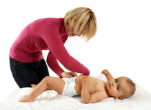 Changing the baby's nappy Stock Photography