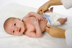 Changing the baby's nappy Royalty Free Stock Images