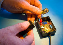 Changing the battery in a radio transmitter. Royalty Free Stock Photography