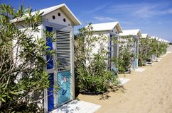 Changing beach cabins Stock Images