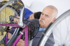 Changing the bike`s breaks. Work royalty free stock photography