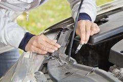 Changing car halogen bulb Stock Photos