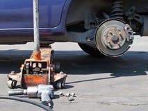 Changing car tire Stock Photos