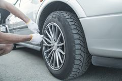Changing car tire. Car service. Tire installation concept stock photos