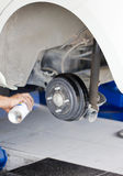 Changing Car Tire By Mechanic Stock Photography
