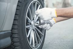 Changing car tire. Car service. Tire installation concept royalty free stock photography