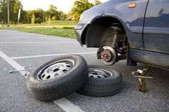 Changing car tires in summer. Manually changing tires for the summer season stock photo