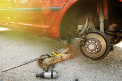 Changing car tyre home garage Royalty Free Stock Image