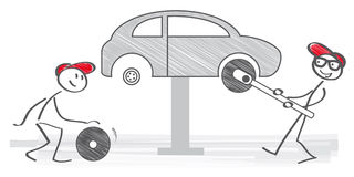 Changing car wheel. Two mechanician changing car wheel in auto repair shop stock illustration