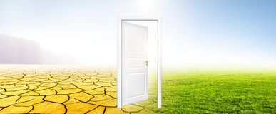 Changing climate from drought to green meadow stock image