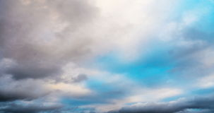 Changing cloud against moving clouds and blue sky time-lapse stock footage