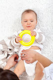 Changing diapers on a baby girl Stock Photos