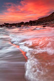 Changing Directions, Bodega Bay, Ca. Just outside Bodega Bay, California water, rocks and cliffs are basked in color from an exceptional sunset Royalty Free Stock Photography
