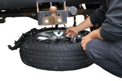 Changing exploded truck wheel Royalty Free Stock Photo