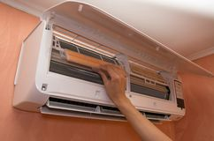 Changing filter in air conditioner on the wall royalty free stock images
