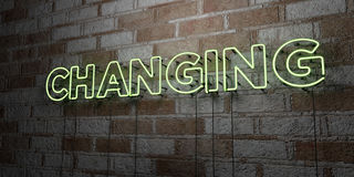 CHANGING - Glowing Neon Sign on stonework wall - 3D rendered royalty free stock illustration Royalty Free Stock Photography