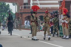 The changing of the guard at the border between India and Pakistan. Amritsar, India - changing of the guard is one of the main attractions for tourists visiting royalty free stock image
