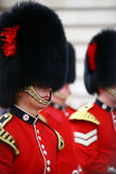 Changing of the guard at buckingham palace. LONDON - JULY 28: Her Majesty's Coldstream Regiment of Foot Guards, also known officially as the Coldstream Guards Royalty Free Stock Image