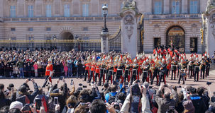 Changing the guard at Buckingham Palace, London. Parade of guards of the Queen marching in uniform Royalty Free Stock Photography