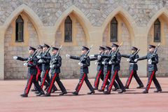 Changing guard ceremony in Windsor Castle, England. WINDSOR, ENGLAND - JUNE 09, 2017: Changing guard ceremony with marching soldiers in Windsor Castle, country royalty free stock image
