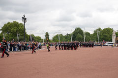 Changing of the Guards ceremony at Buckingham Palace. London, England - July 18, 2008 : Marching the Queen's Guards during traditional Changing of the Guards stock photos
