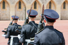 Changing guards with soldiers armed with rifles in Windsor Castle. WINDSOR, ENGLAND - JUNE 09, 2017: Changing guard ceremony with soldiers armed with rifles and royalty free stock photography