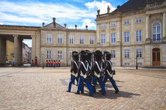 Changing of her Majesty`s guard at Amalienborg Castle. The ceremony of changing the Royal Guard in Amalienborg Castle in Copenhagen in Denmark stock images