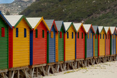 Changing huts at Muizenberg. Famous changing huts for bathers on the beach at Muizenberg Royalty Free Stock Image