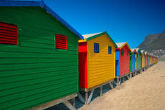 Changing huts at Muizenberg. Famous changing huts for bathers on the beach at Muizenberg (South Africa Royalty Free Stock Photos