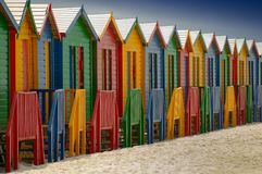 Changing huts at Muizenberg. Famous changing huts for bathers on the beach at Muizenberg (South Africa Royalty Free Stock Photo