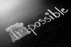 Changing impossible into possible on a chalkboard Royalty Free Stock Photography